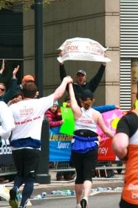 Running toward Ren with Team Fox sign